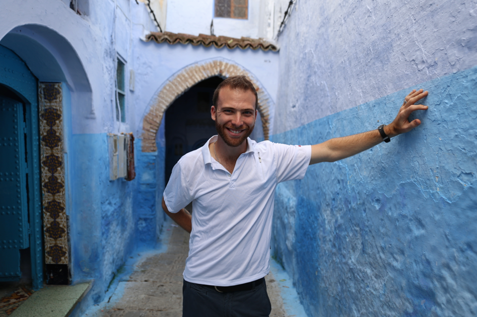 man standing in chefchaouen morocco